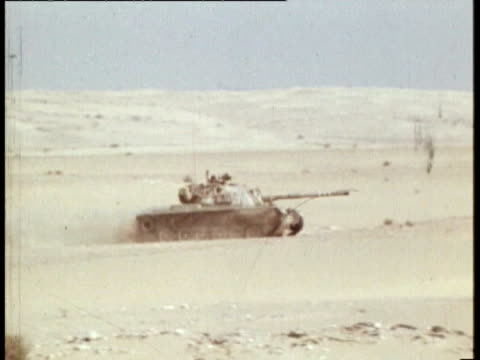 Sinai Mitla Pass EXT Israeli Soltam L33 155mm self propelled guns in action Israeli M60 tank quickly along Soltam guns used shell casings M60 tank...