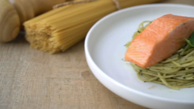 pasta spaghetti with pesto green and salmon