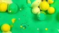 Pastel green and yellow and gold spheres 3 vibrant bright paint and oil color swirls entropy