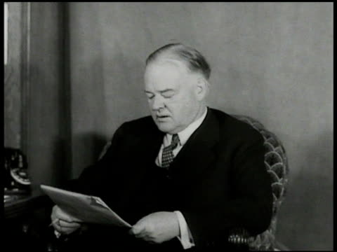 INTERVIEW PastPresident Herbert Hoover sitting at desk w/ unidentified man taking notes saying he only wants country to know issues criticizing 'New...