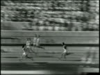 400 Meter Relay Won by United States Time 040 New World's Record / Long pan of last leg of the relay beginning with one runner waiting at the...