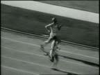 Pathe News / Title card reads 400 Meter Run Final Won by Carr US No 408 Time 0 462 New World's Record / High wide pan of runners rounding the bend on...