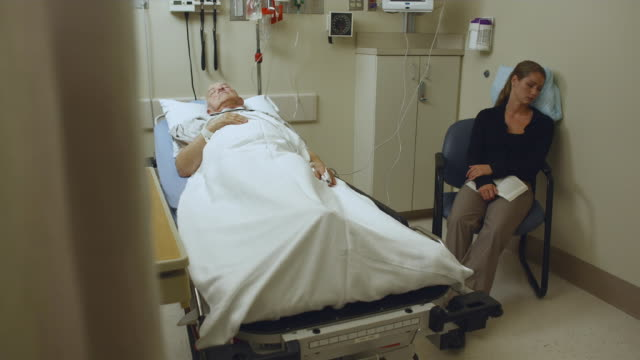 WS PAN Patient and visitor sleeping in hospital room / Edmonds, Washington, USA