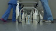 POV Patient on a stretcher being transported down the hospital hallway