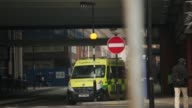 A patient transport vehicle enters the Royal London Hospital in London United Kingdom on Thursday January 22 gvs of ambulances outside the hospital...