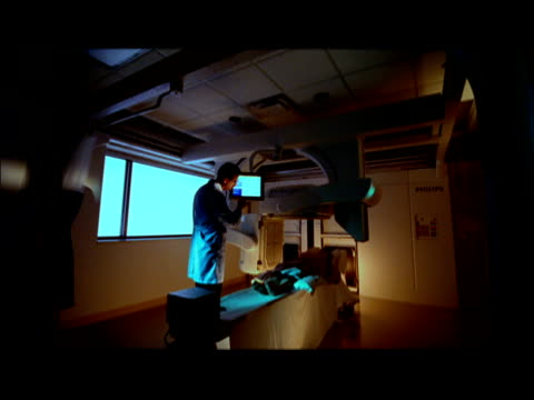 WS, CS, Patient undergoing MRI with doctor in attendance, Swedish American Hospital, Rockford, Illinois, USA