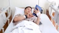 Patient using digital tablet