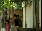 Patients and nurses outside drugs rehabilitation centre Tajikistan