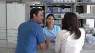 Patients asking a nurse at the pharmacy for prescribed meds