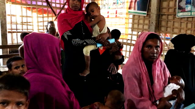 Patients wait for medical treatment in the urgent out patient waiting area at the 'Doctors Without Borders' Kutupalong clinic on October 3 2017 in...