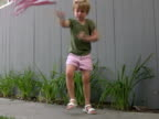 Patriotic American Child Waves Flag