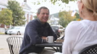 PAN Patrons enjoying food and coffee at outdoor cafe / Stowe, Vermont, United States