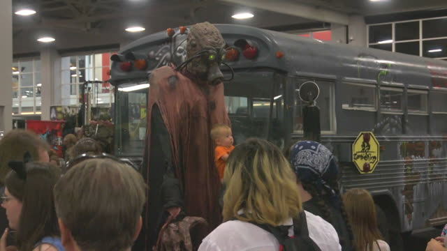 Patrons of the first annual Comic Con is Salt Lake City Utah pose for photos with a monster