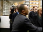 SIDE CMS Paul Boateng MP shaking with police officer LIB ENGLAND London Westminster Diane Abbott MP towards into room