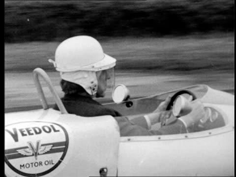Paul Getty tries out his new racing car ENGLAND Goodwood Racecourse TS Car Getty gets into the car puts his helmet on TMS Paul Getty wearing helmet...