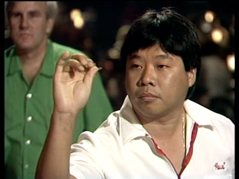 Paul Lim celebrates as he checks out on 141 to become first player to complete nine dart finish at World Darts Championship Lakeside Frimley Green...