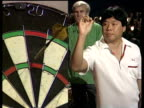Paul Lim scores 180 with second throw of famous leg where he became first player to complete nine dart finish at World Darts Championship Lakeside...