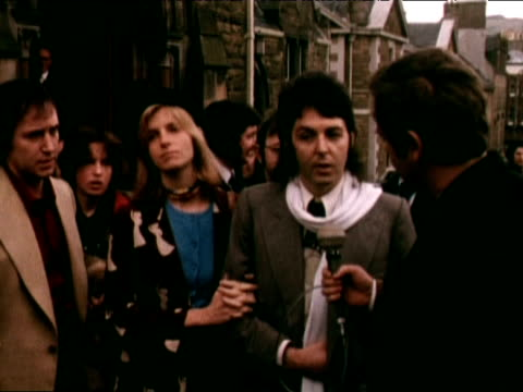 Paul McCartney stands beside wife Linda talking about his Father being a