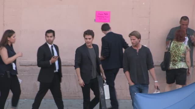 Paul Wesley exchanges greeting with fans while departing the 2014 Teen Choice Awards in Los Angeles in Celebrity Sightings in Los Angeles