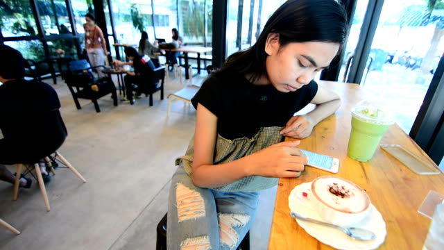 Paying With NFC Technology on Smart Phone in Coffee Shop