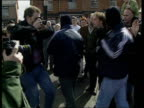 Peace ITN N IRELAND Belfast IRA gunmen wearing balaclavas and carrying guns thru cheering crowd at Easter rally S Armagh Soldiers on patrol next army...