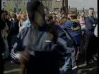 Peace ITN N IRELAND Belfast NIGHT Irvine i/c IRA gunmen wearing balaclavas and carrying guns thru cheering crowd at Easter rally TRACK ROUND Belfast...