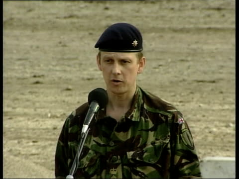 NATO peace talks ITN MS Two soldiers on duty as one yawns Talks tent with press behind cordon in f/g Colonel Robin Clifford up to mic and speaking to...