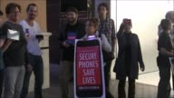 Peaceful antiFBI protesters at the Fashion Valley Mall in front of the Apple store Protesters do not want the federal government to hack into iPhones...
