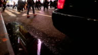 pedestrian and vehicle traffic with standing water | curb-level view