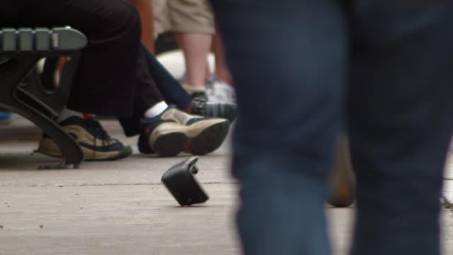 Pedestrian drops wallet