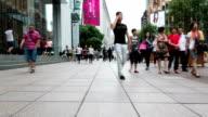 Pedestrian walking in modern street in shanghai ,time lapse.