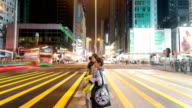 pedestrian walking through crossroad in street of hongkong,time lapse.