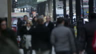 Pedestrians and background traffic in downtown Chicago. Faces blurred.