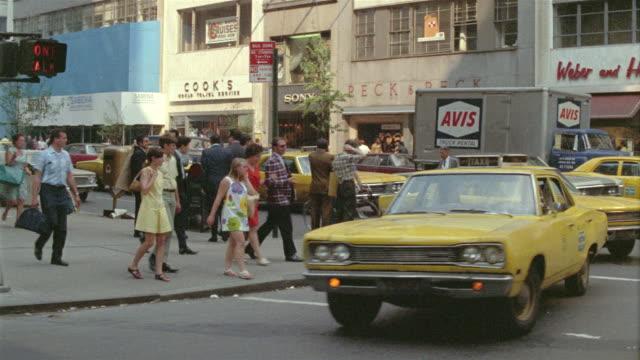 1965 MS Pedestrians and traffic on busy Manhattan street / New York City, New York
