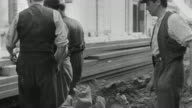 1939 MONTAGE Pedestrians and workers in a city, air raid siren going off, people entering buildings and air raid shelters, closing doors, and leaving empty streets behind during World War II / United Kingdom