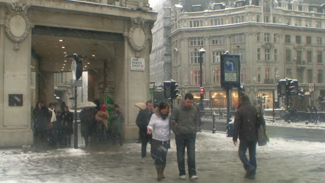 WS Pedestrians at Regent Street in snow, London, United Kingdom