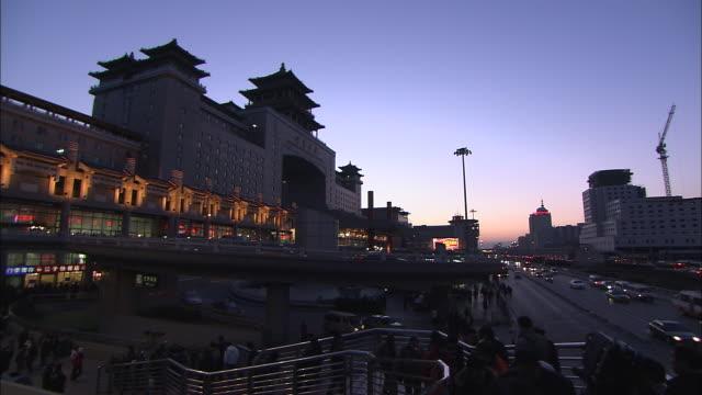 Pedestrians climb steps near the Beijing West Railway Station.