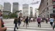MS Pedestrians cross a busy street in Anhangabau, downtown Sao Paulo / Sao Paulo, Brazil