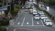Pedestrians cross a road in the Makati district of Manila the Philippines on Monday Nov 16 Elevated view of cars and jeepneys driving on a road in...