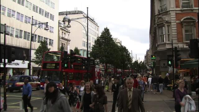 Pedestrians cross a street in London.