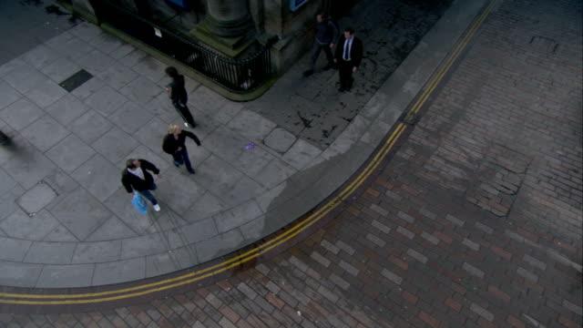 Pedestrians cross Buchanan Street in Glasgow, Scotland. Available in HD.