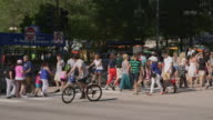 WS PAN Pedestrians crossing at intersection downtown