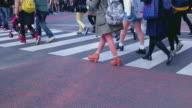 Pedestrians crossing street in Harajuku.