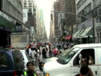 Pedestrians crossing street while vehicle wait in traffic during citywide blackout on August 14 2003 / New York New York USA / AUDIO