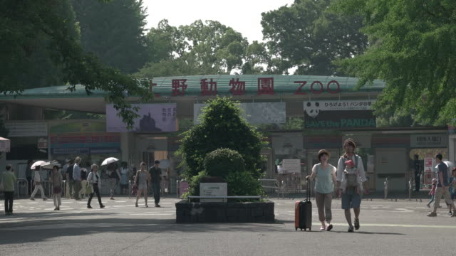 Pedestrians front of Ueno park zoo .Tokyo,Japan