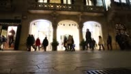Pedestrians on a high street in Barcelona Spain on Tuesday Dec 27 Adidas Emporio Armani