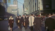 1959 MS Pedestrians on busy Manhattan sidewalk during winter / New York City, New York