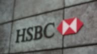 Pedestrians pass a HSBC Holdings Plc bank branch in the City of London UK on Monday August 4 Automated teller machines outside a HSBC Holdings Plc...