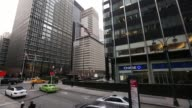 Pedestrians pass the headquarters of JPMorgan Chase Co in New York US on Tuesday January 12 2016 JP Morgan Chase Co is scheduled to release earnings...