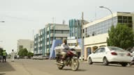 Pedestrians pass the headquarters of the Commercial Bank of Chari Chad in N'Djamena Chad on Tuesday Aug 15 2017